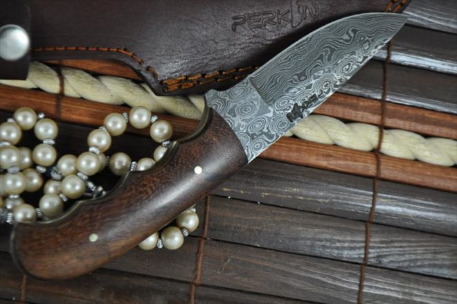 Handcrafted Damascus Steel Hunting Knife - Unique File Work In Spine